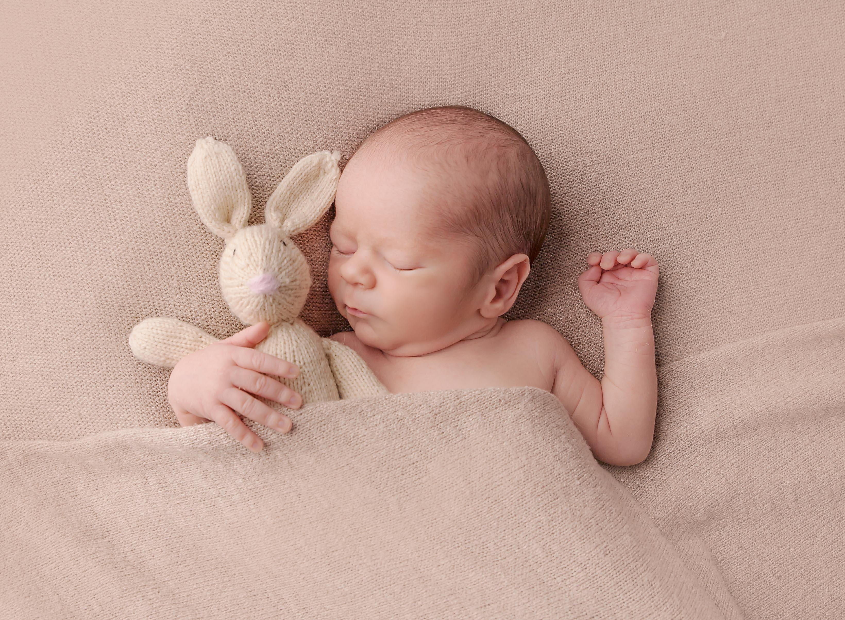 newborn with stuffie photographer cumberland, B.C