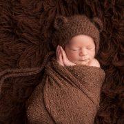 newborn in bear hat photographer cumberland, B.C