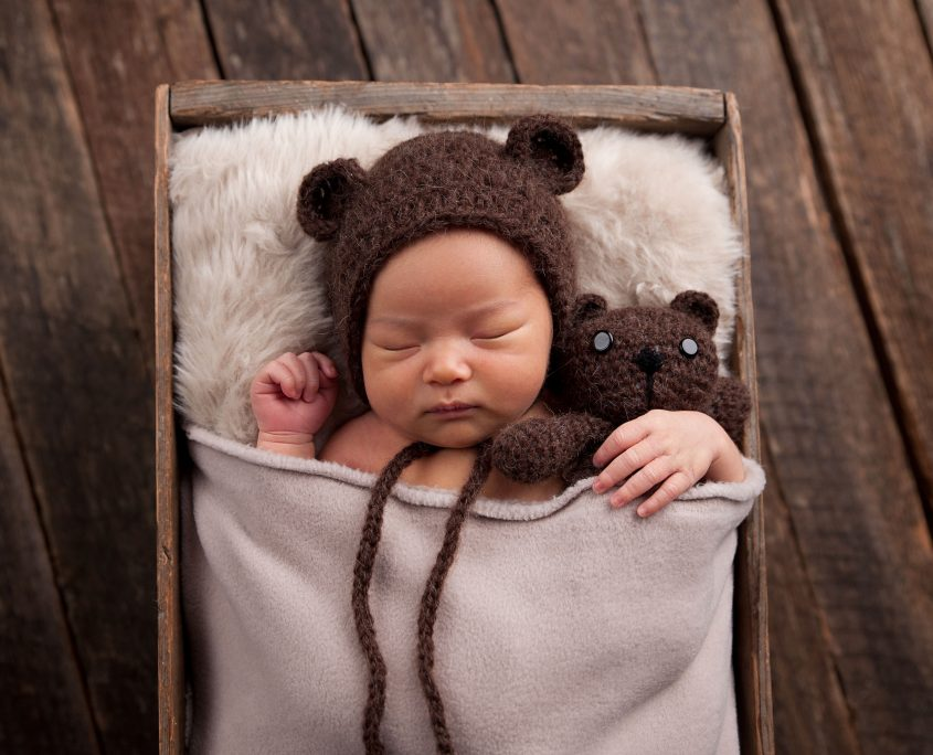 newborn with teddy courtenay